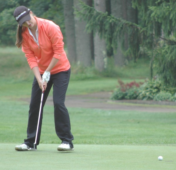Monica Austin of the Woodlands drains this putt on the 12th hole during the 2013 Women's Amateur at Brunswick Golf Club on Monday.