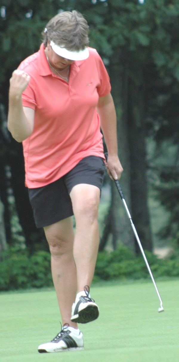 Bangor Municipal's Liz Coffin pumps her first after sinking a birdie putt on the 15th hole during the 2013 Maine Women's Amateur Golf Championship at Brunswick Golf Club on Monday.