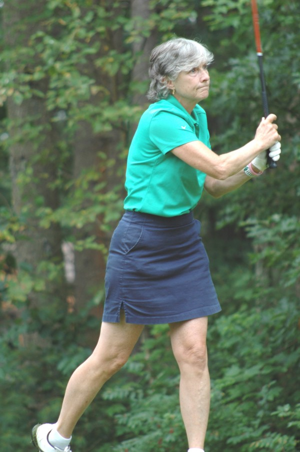 The Woodlands Laurie Hyndman watches her drive on the 10th hole.