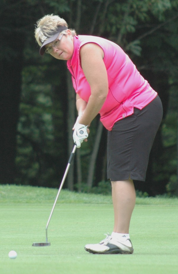 Darby Vigue of Hermon Meadows is about to sink this par putt on the 14th hole during the 2013 Maine Women's Amateur Golf Championship at Brunswick Golf Club on Monday in opening round action.