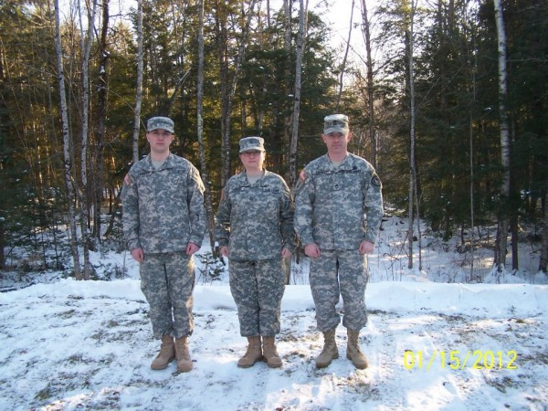 Spc. Andrew Parker (left) and his mother, Spc. Holly Parker, who are both preparing to deploy to Afghanistan with the Gardner-based 133rd Engineer Battalion, pose for this photo last year with husband and father, Sgt. 1st Class Randall Parker, who deployed with the 133rd to Iraq in 2004-05.