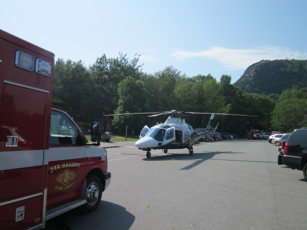 A LifeFlight helicopter sits in the parking lot at Sand Beach in Acadia National Park on Wednesday before transporting an injured rock-climbing guide to Eastern Maine Medical Center in Bangor.