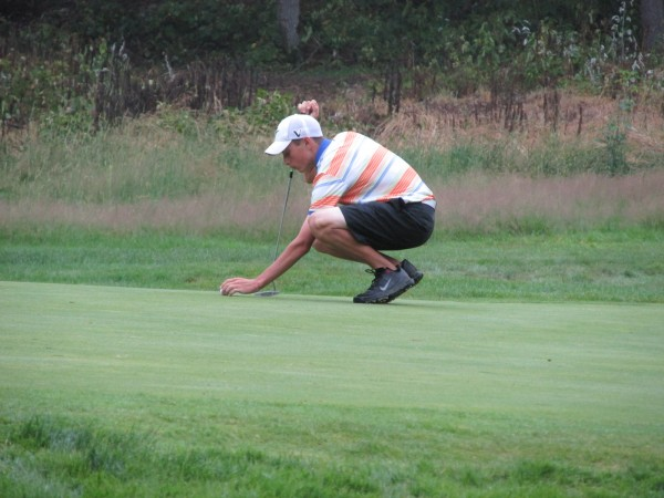 Drew Powell of Bangor putts on the 17th hole Wednesday during the Maine Amateur Championship golf tournament at Augusta Country Club.