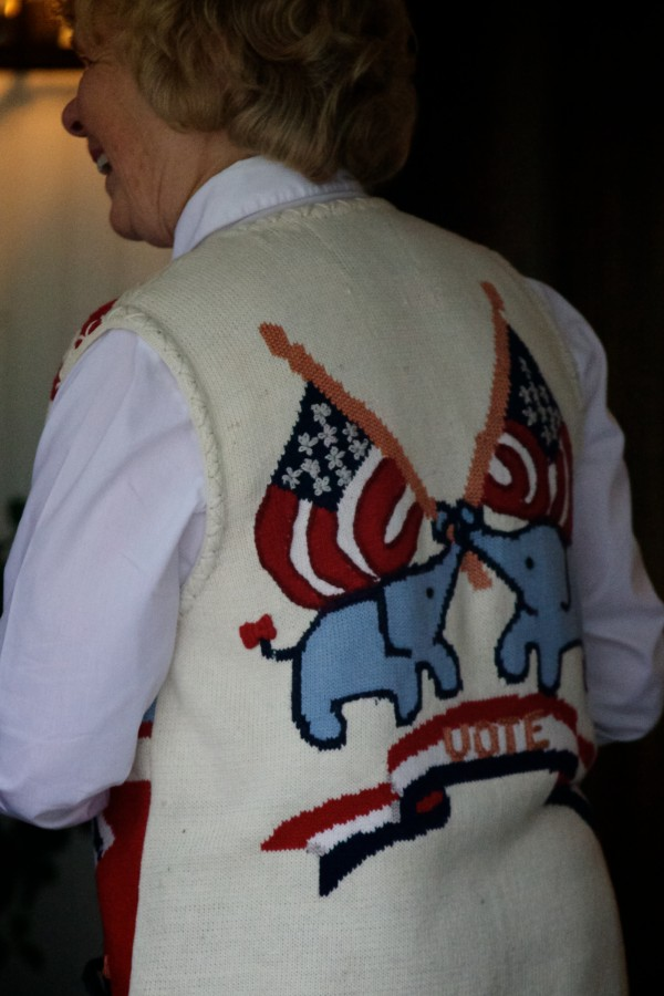 A woman with a vivid vest arrives at the Nonantum Resort in Kennebunkport on Tuesday as a Paul LePage re-election fundraising event, featuring keynote speaker Jeb Bush, got underway