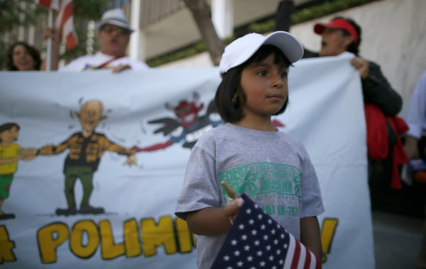 Maria Cervantes, 6, takes part in a 24-hour vigil calling on Congress to pass immigration reform in Los Angeles, June 27, 2013.