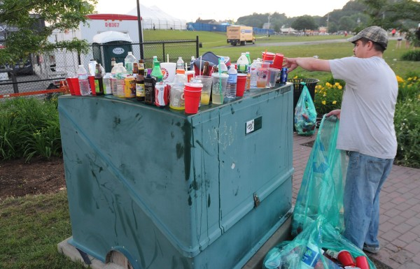 Eric Clark of Bangor says he expects to make about $60 from picking up discarded bottles and cans outside the Phish show at the Darling's Waterfront Pavilion on Wednesday.