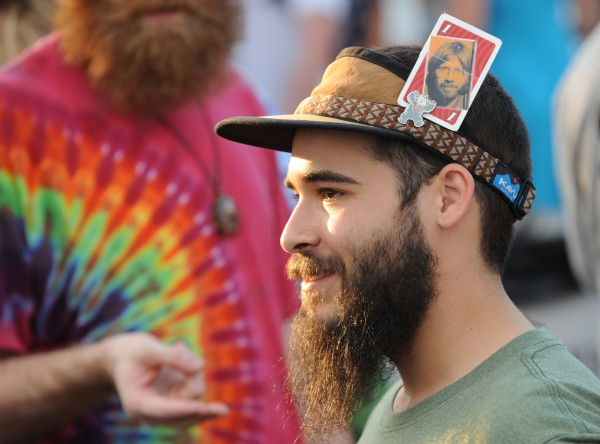 Elias Landsman of Asheville, N.C., sports a card with a picture of Trey Anastasio on it as he enters the gate to see Phish perform along the Bangor Waterfront on Wednesday.