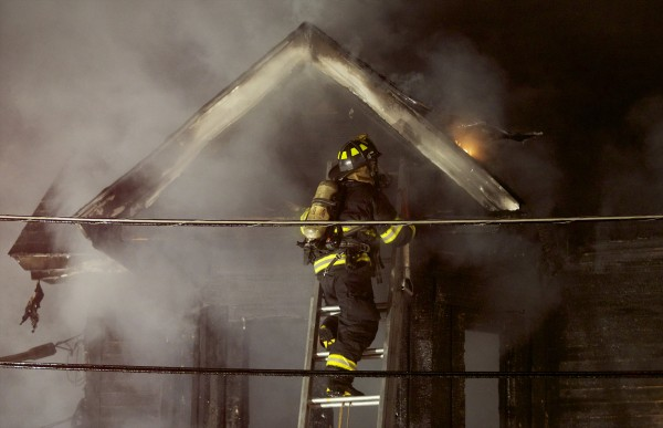 Emergency crews fight a structure fire at the corner of Patten and Hellier streets that destroyed a home late Monday evening in Bangor.