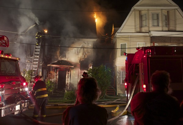 Emergency crews battle a fire at the corner of Patten and Hellier streets late Monday evening.
