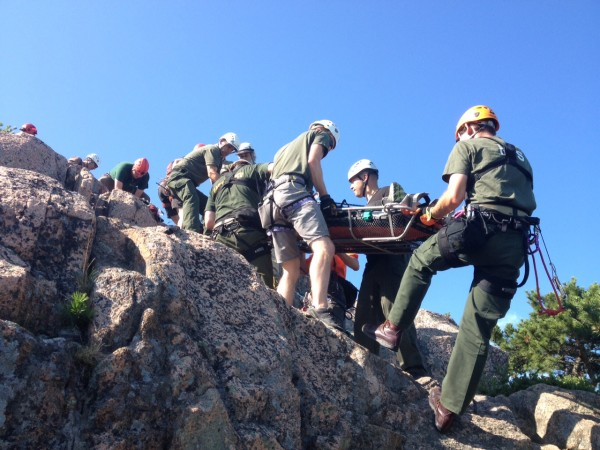 Acadia National Park rangers and members of Mount Desert Island Search & Rescue help lift an unidentified 62-year-old woman to safety on the Beehive Trail on Wednesday after she slipped on some metal rungs on the steep trail and fractured her leg, according to park officials.