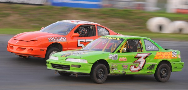Garett Hayman of Milford (3) battles with Travis Beal of Hampden for the lead in the Little Enduro feature during Wacky Wednesday racing at Speedway 95 in Hermon. Hayman took the checkered flag, but was disqualified for a low race height, so Beal earned the win.