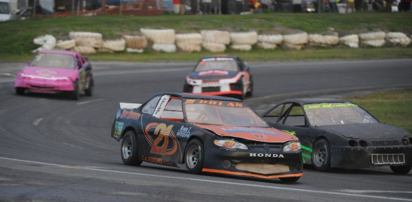 Bradley Dolan (21) of Glenburn races in the Sport-Four heat at Speedway 95 in Hermon on Thursday night. Donny Silva of Hudson went on to win the race. Thursday night's feature event, the John Phippen Jr./Allan Fletcher Memorial Late Model races, was suspended due to rain and will resume Saturday night, July 27.