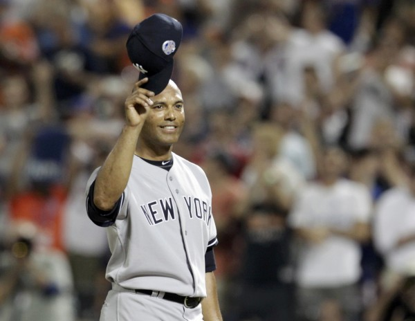 American League pitcher Mariano Rivera of the New York Yankees takes his cap off to a standing ovation as he steps to the mound in the eighth inning against the National League during Major League Baseball's All-Star Game in New York, July 16, 2013.