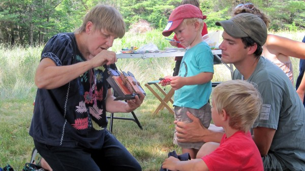 Participants of all ages enjoy puppetry with Nancy Tyndall at the 2012 Midsummer Celebration.