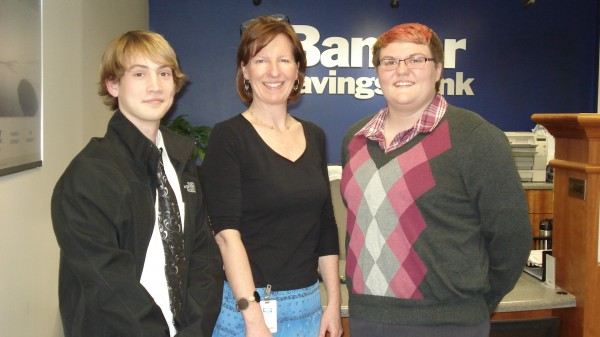 Oceanside sophomores Kaleb Robinson and Bailee Cox with Mary Bumiller, AVP, Branch Manager of Bangor Savings Bank in Rockland.