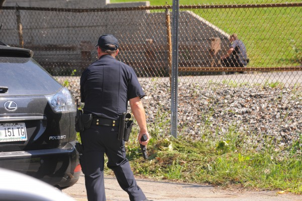 Police respond to a man with a gun in a residence on Park Street in Bangor, ME.