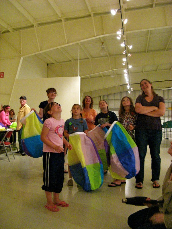 Workshops participants are dazzled by the finished project after completing the hot air balloon workshop at the Owls Head Transportation Museum.