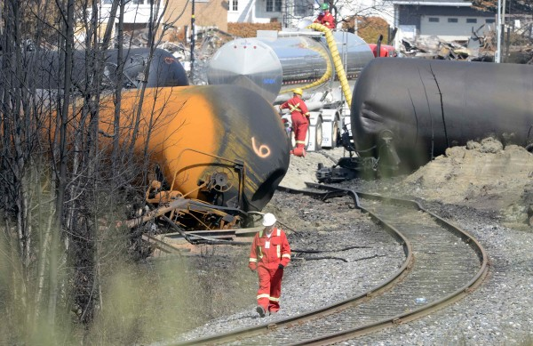A worker walks near the railway track on the site of the train wreck in Lac Megantic, July 16, 2013.