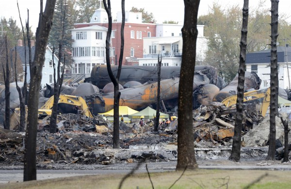 An emergency worker stands on the site of the train wreck in Lac Megantic, July 16, 2013.