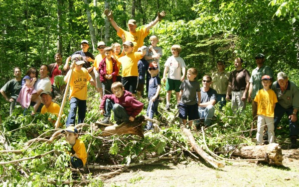 Camden Area Cub Scouts and their dads clear brush from campsites at Camden Hills State Park on Father's Day weekend