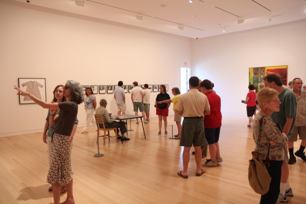 Community members check out art in the new addition at the Colby College Museum of Art on Sunday, July 14.