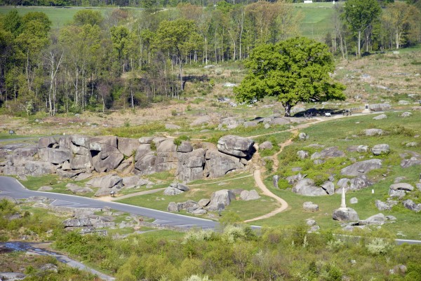 The Devil's Den is the local name applied to the mass of jumbled boulders located at the south end of Houck's Ridge at Gettysburg, Pa. The Devil's Den was the scene of intense fighting involving the 4th Maine Infantry Regiment and other Union and Confederate regiments on Thursday, July 2, 1863. The 4th Maine's monument is located on a boulder at lower right in the photo.