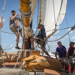 The crew aboard the Mary Day work hard to win the 2013 Great Schooner race in Rockland, ME