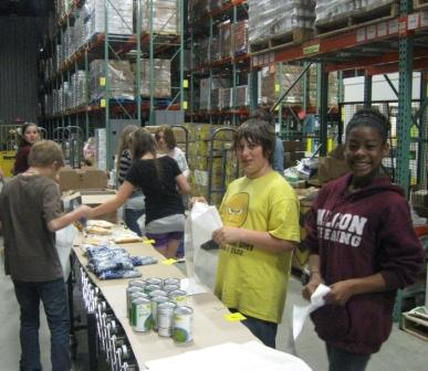 JMG students at Freeport Middle School organized food contributions at the Good Shepherd Food Bank as part of their Jumpstart Our Youth student philanthropy work