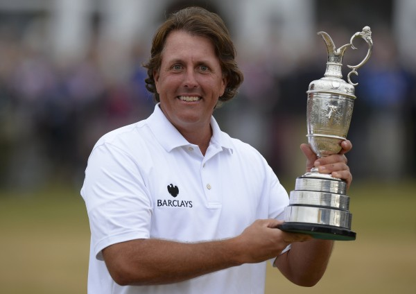 Phil Mickelson of the U.S. smiles as he holds the Claret Jug after winning the British Open golf championship at Muirfield in Scotland July 21, 2013.