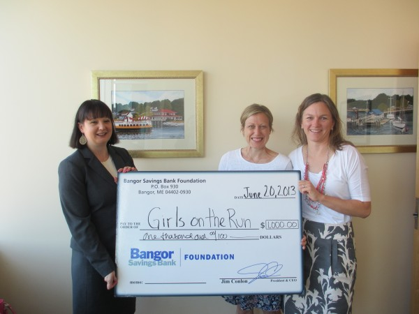 Laura Huddy, Bangor Savings Bank Vice President, Commercial Banking Officer (left); Girls on the Run - Maine. Board Chair, Megan Tumavicus (right); and 