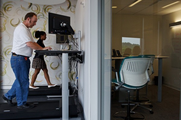 Michelle Schneider and Dave Dunn use the treadmill desks at Evolent, a health care startup company in Arlington, Va, on June 26, 2013.