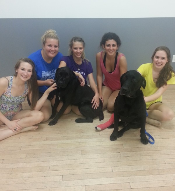 Recent Top Hat II Dance Studio graduates Dayna White, Kelsey Gifford, Chelsea Richards, Ashton Ortiz and Olivia Barberi take a break from rehearsal to share some love with Louie and King, who were adopted from the Bangor Humane Society by Dave, Sandy and Krysti Sanzaro.  The dancers are preparing for a benefit performance at 6 p.m. Sunday July 21, at John Bapst Memorial High School.  Admission is by donation, with all proceeds going to the Bangor Humane Society. For information, e-mail tophatii@aol.com or call 989-3900.