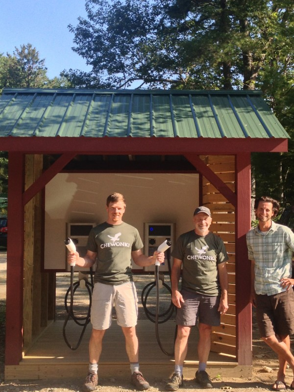 Chewonki sustainability officer Tom Twist, (R to L) technician Jamie Kane,and facilities manager Carob Arnold show off the new car charging station. Photo  courtesy of Chewonki