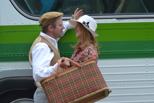 Kevin and Michelle Allen, owners of Ambidextrous Inc, a Seashore Trolley Museum Business Member model vintage pieces in front of an antique bus.Michelle's hat and clutch on loan from LACAVA, another Business Member.