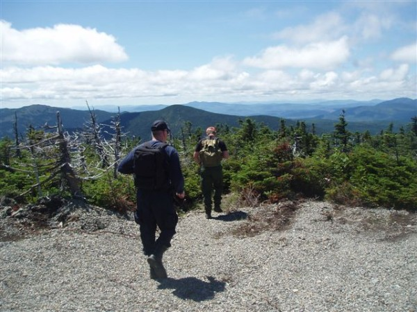 Sergeant Jeff Spencer and Maine State Police Detective Lenny Bolton hiking towards Spaulding Mountain from the summit of Sugarloaf. Game wardens continue searching for hiker Geraldine Anita Largay who went missing while hiking the Appalachian Trail.