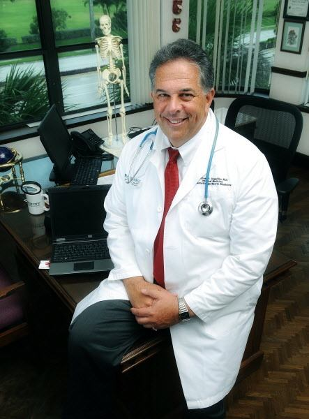 Dr. Michael Angelillo, an internist and rheumatologist, has worked with others on a patent-approved system that stores medical info in the &quotcloud&quot -- ready for medical personal to access, especially in an emergency situation. The system collects and stores a patient's medical records, images, lab results, medications, allergies and special instructions all within a highly encrypted secure system. Angelillo posed for a photo in his North Palm Beach, Fla., office on July 2, 2013.