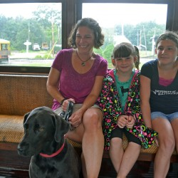 Lisa Lassey, Associate Director of Kennebunkport Conservation Trust with daughters Carly and Samantha and family dog Mack set out for Seashore Trolley Museum's Talbott Park.