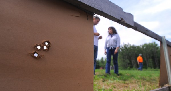 People check targets and post new ones during a monthly shoot at the Penobscot Longrifles shooting range in Stetson.