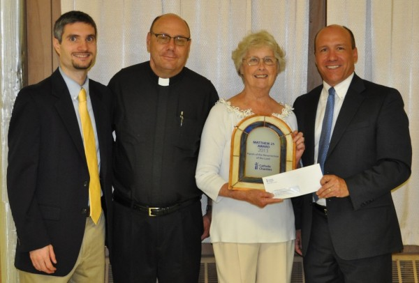 Michael Smith, (left) Program Manager for Catholic Charities' Parish Social Ministry; Fr. Phil Labbe; Mary Montville, Chair of the Social Justice and Peace Commission for The Parish of the Resurrection of the Lord; and Catholic Charities CEO Stephen Letourneau.