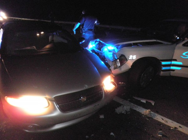 Damage to Saco Police Department cruisers after a Massachusetts woman allegedly rammed her convertible into several police vehicles.