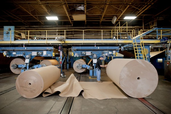 An International Paper Co. employee works on the floor of the company's factory in Mount Carmel, Pa. International Paper spent $1.15 million lobbying the Internal Revenue Service and other parts of government on tax issues in 2010.