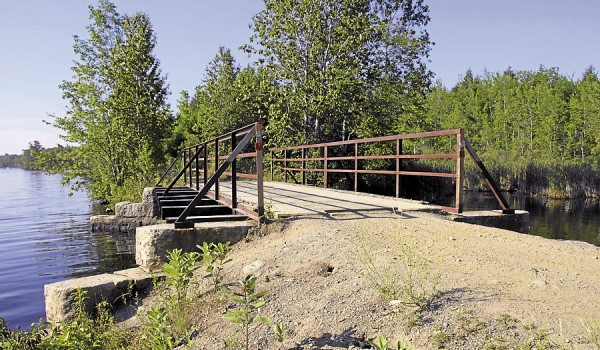 A bridge carries the Central Maine Adventure Trail across an inlet at the northwest corner of Sebasticook Lake in Newport.