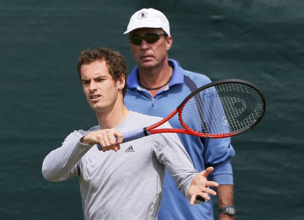 Andy Murray of Britain trains, with his coach Ivan Lendl (right), on a practice court at the Wimbledon Tennis Championships, in London July 4, 2013.