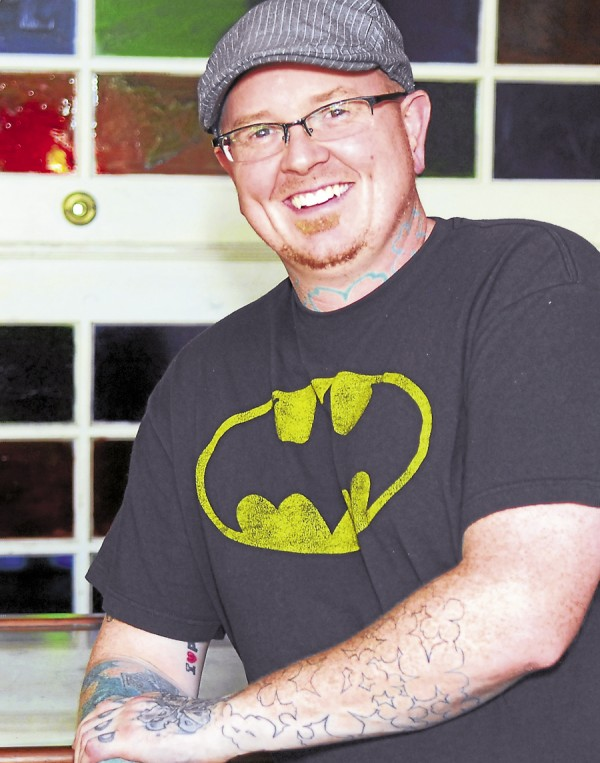Matthew Moore, of Forecastle Tattoo, at is his shop on State Street Hill in Bangor.
