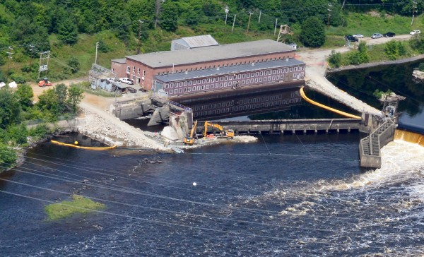 Demolition crews breach the Veazie Dam Monday in Veazie, Maine.