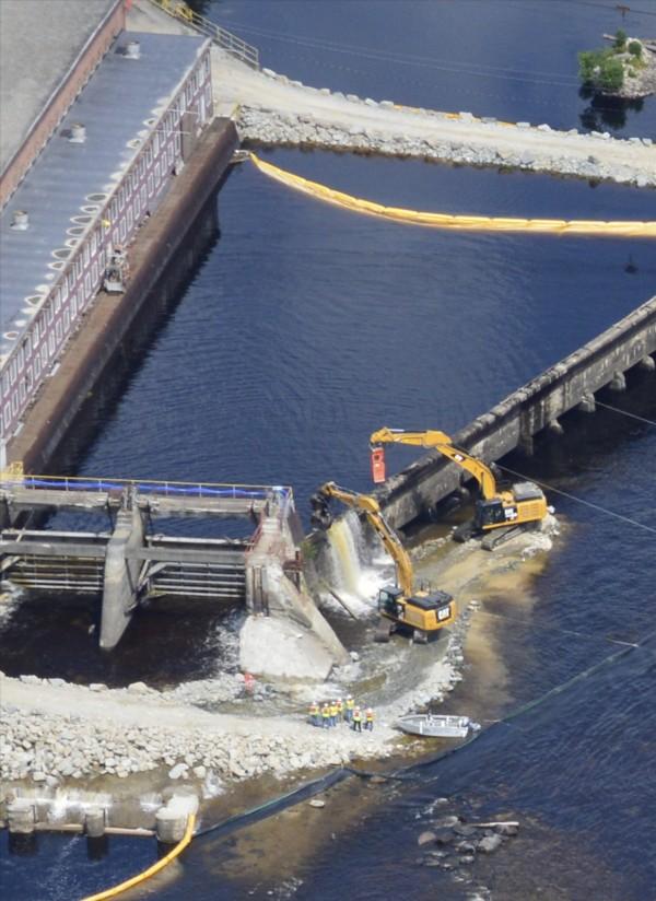 Demolition crews breach the Veazie Dam Monday in Veazie, Maine.