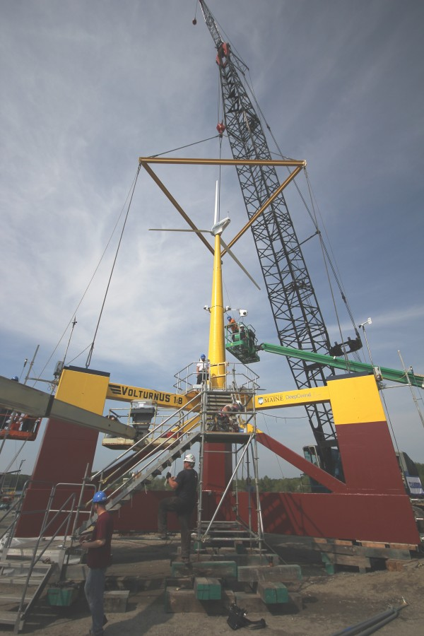 On May 30, 2013, workers build VolturnUS, a first-of-its-kind wind turbine designed and built at the University of Maine, which became in June the first grid-connected offshore wind turbine in the Americas to provide electricity to the power grid.