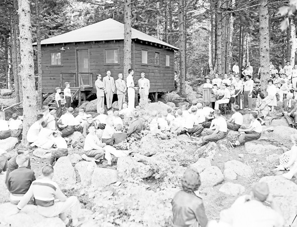 Bangor Daily News Photo by Spike Webb  Shown above are the dedication ceremonies of a new cabin held at Camp Jordan on Sunday afternoon, July 1, 1951. The cabin was presented to the camp by the Bangor Junior Chamber of Commerce. Standing in the middle of the picture are (from left) Joseph Taylor of the Jaycee Youth committee; William T. Bennett Jr., camp director; W. Weldon Dunnett,; the Rev. Charles A. Marstaller, pastor of the Essex Street Baptist Church; and Danforth E. West, Jaycee president.