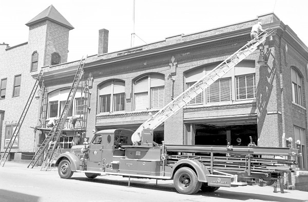 Members of the Bangor Fire Department took advantage of the good weather on Monday, May 11, 1953 to begin a repainting of Central Station on Union Street. The number two ladder truck was hauled out and put to use and most of the available manpower was armed with brushes. According to Chief John J. Nelligan, all of the structure except the bricks will be painted, and the most surprising thing of all is the fact that the boys are getting away from the traditional green which had decorated the station from its beginning. This time they're using gray, figuring it will wear better.
