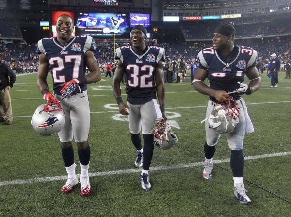 In this 2012 file photo, New England Patriots Tavon Wilson (27), Devin McCourty (32) and Alfonzo Dennard (37) walk off the field. Dennard was arrested for suspicion of driving under the influence in Nebraska on Thursday.